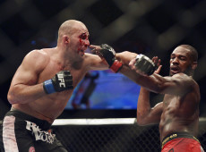 Apr 26, 2014; Baltimore, MD, USA;  Jon Jones and Glover Teixeira exchange punches during the UFC light heavy weight championship fight at  Baltimore Arena. Jones retained the light heavy height championship by defeating  Teixeria.  Mandatory Credit: Tommy Gilligan-USA TODAY Sports